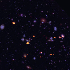 <span>Figure 1: A trove of galaxies, rich in carbon monoxide (indicating star-forming potential) were imaged by ALMA (orange) in the Hubble Ultra Deep Field.</span>