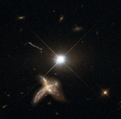 Figure 1: Artist's impression of a quasar and neighboring merging galaxy. The galaxies observed by Decarli and collaborators are so distant that no detailed images are possible at present. This combination of images of nearby counterparts gives an impression of how they might look in more detail.