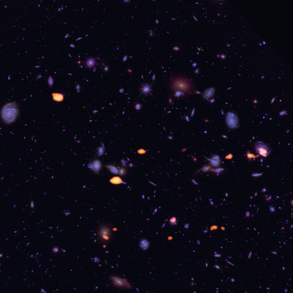 Figure 1: A trove of galaxies, rich in carbon monoxide (indicating star-forming potential) were imaged by ALMA (orange) in the Hubble Ultra Deep Field.