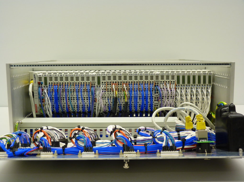 "19"" unit with PLC (programmable logic controller) modules and internal cabling."